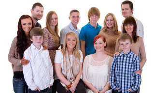 family portraits, large group of grandchildren having a family portrait taken for there gran's christmas present